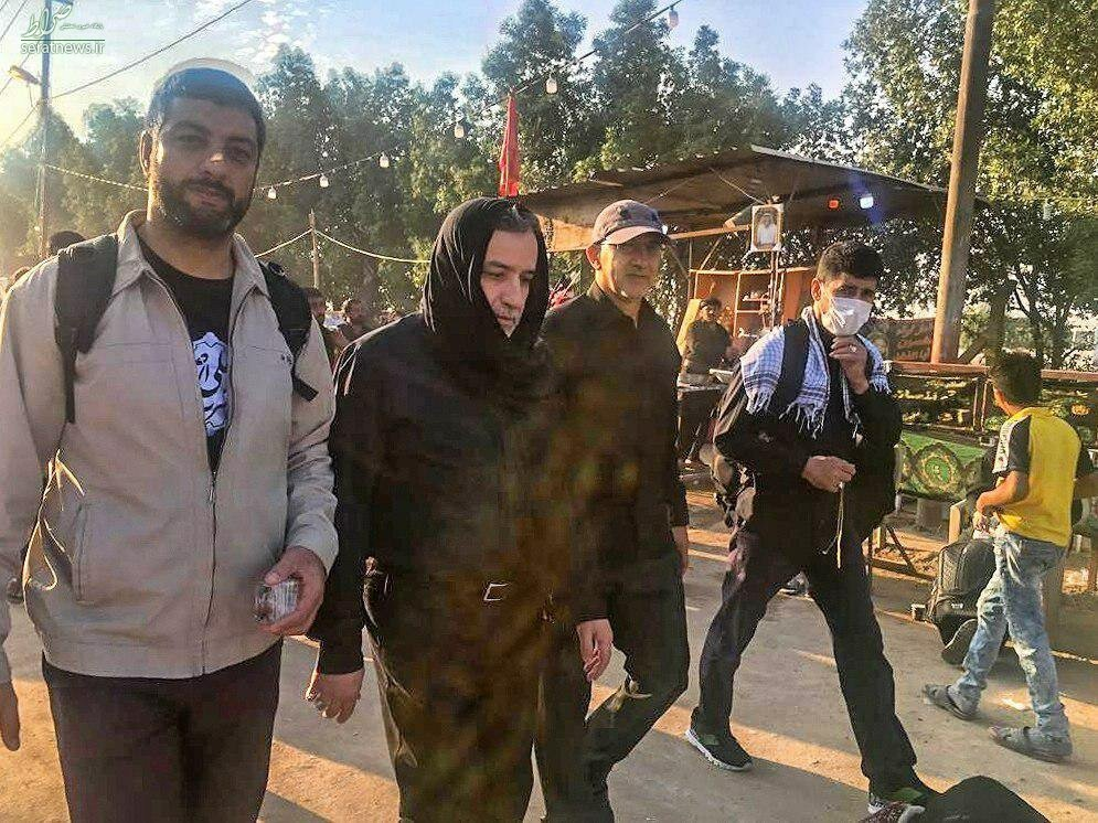 عکس/ صورت پوشیده عراقچی در مسیر راهپیمایی اربعین