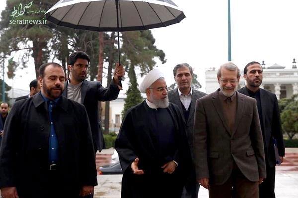 عکس/ استقبال لاریجانی از روحانی زیر باران